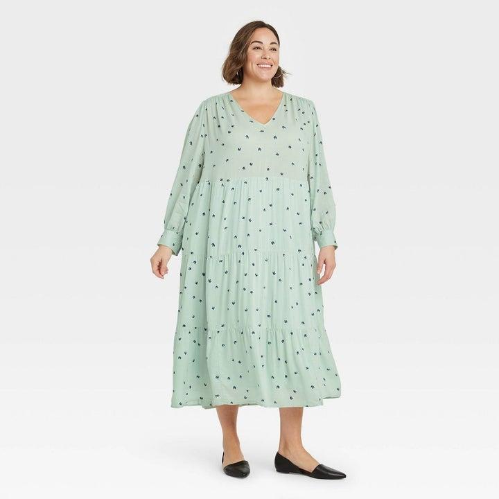 a model wearing the dress in green