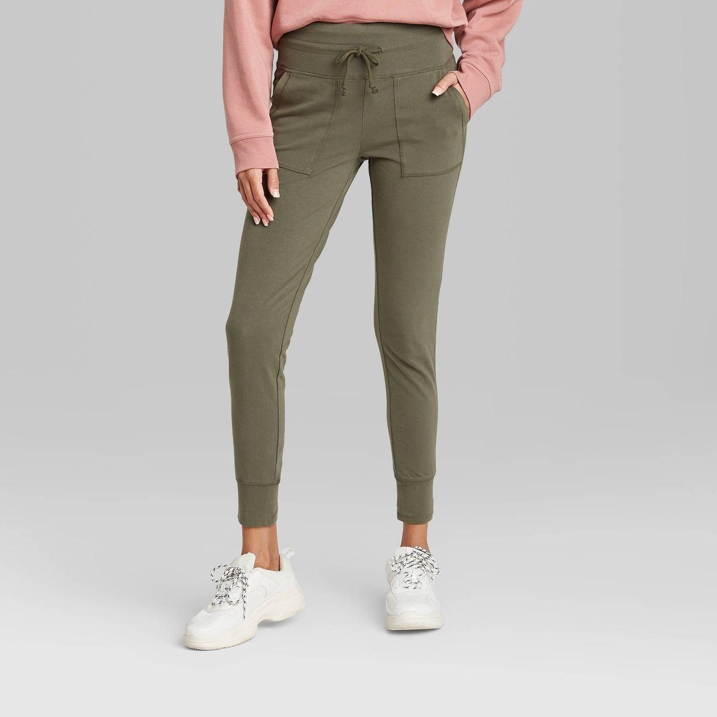 a model wearing green joggers