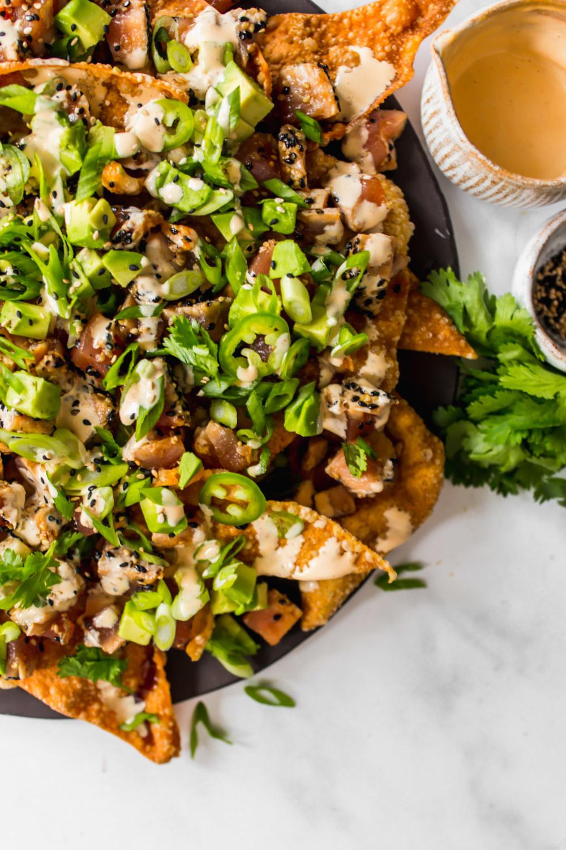 Wonton nachos with ahi tuna poke and greens.