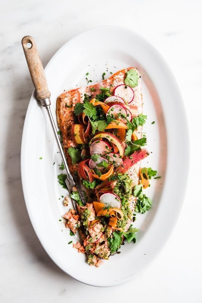 Salmon with vegetables and pesto.