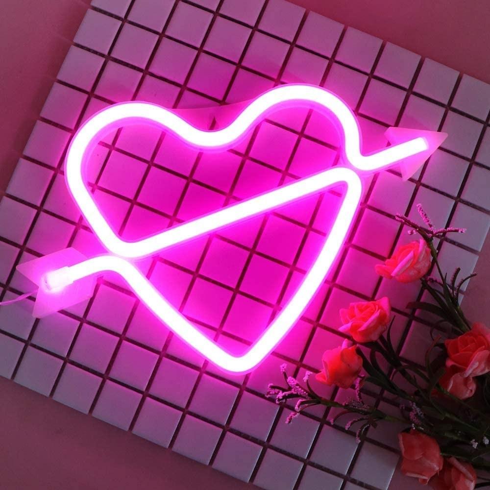 A neon heart with an arrow through it