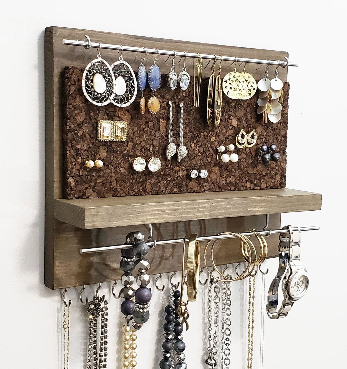 photo of the jewelry organizer styled with necklaces and bracelets and earrings