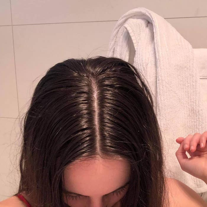 A user showing off greasy roots in their hair