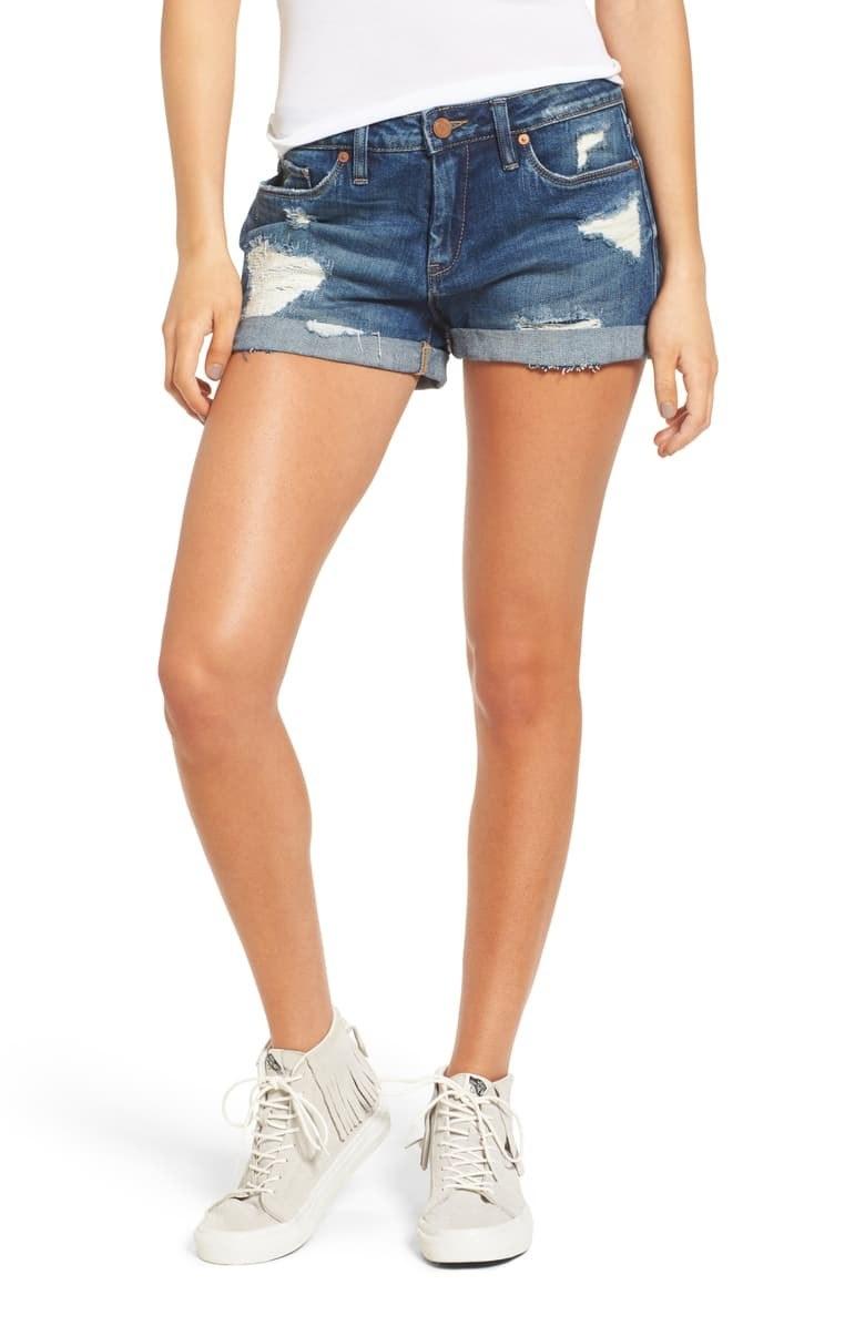 A model wears the jean shorts