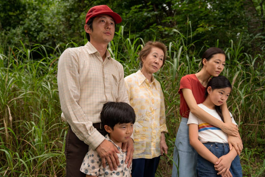 A Korean immigrant family stands outdoors in a still from Minari