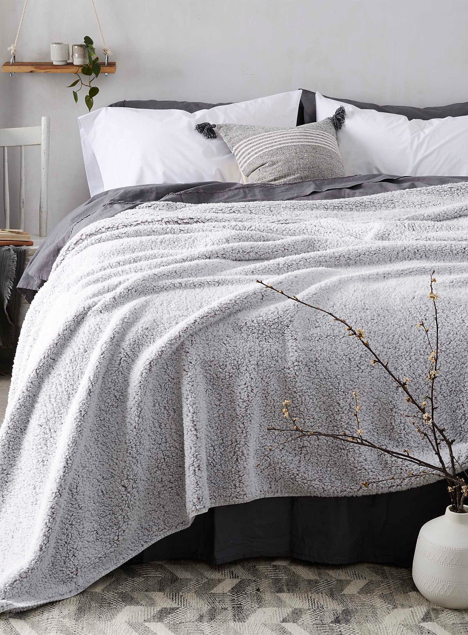 A fluffy blanket draped over a bed