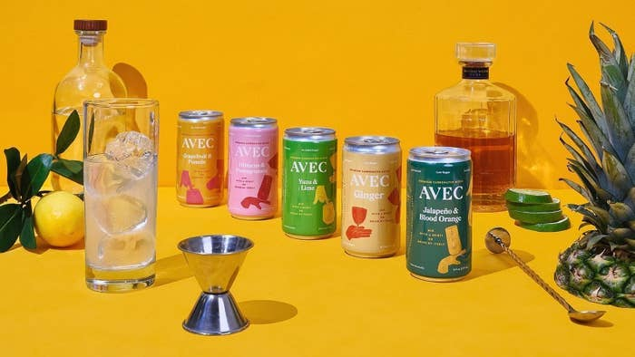 five cans of the mixer in different flavors