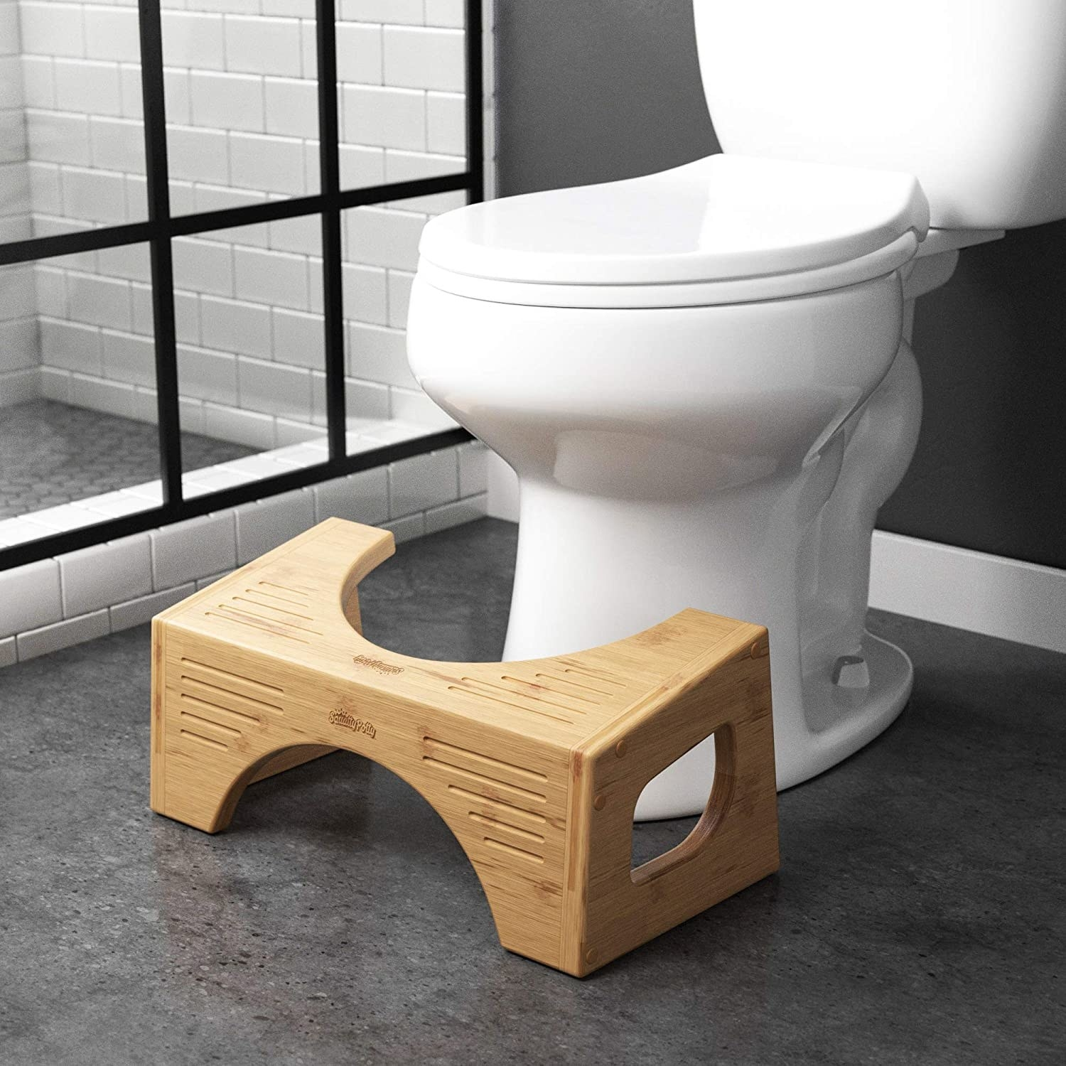 Squatty potty on bathroom floor