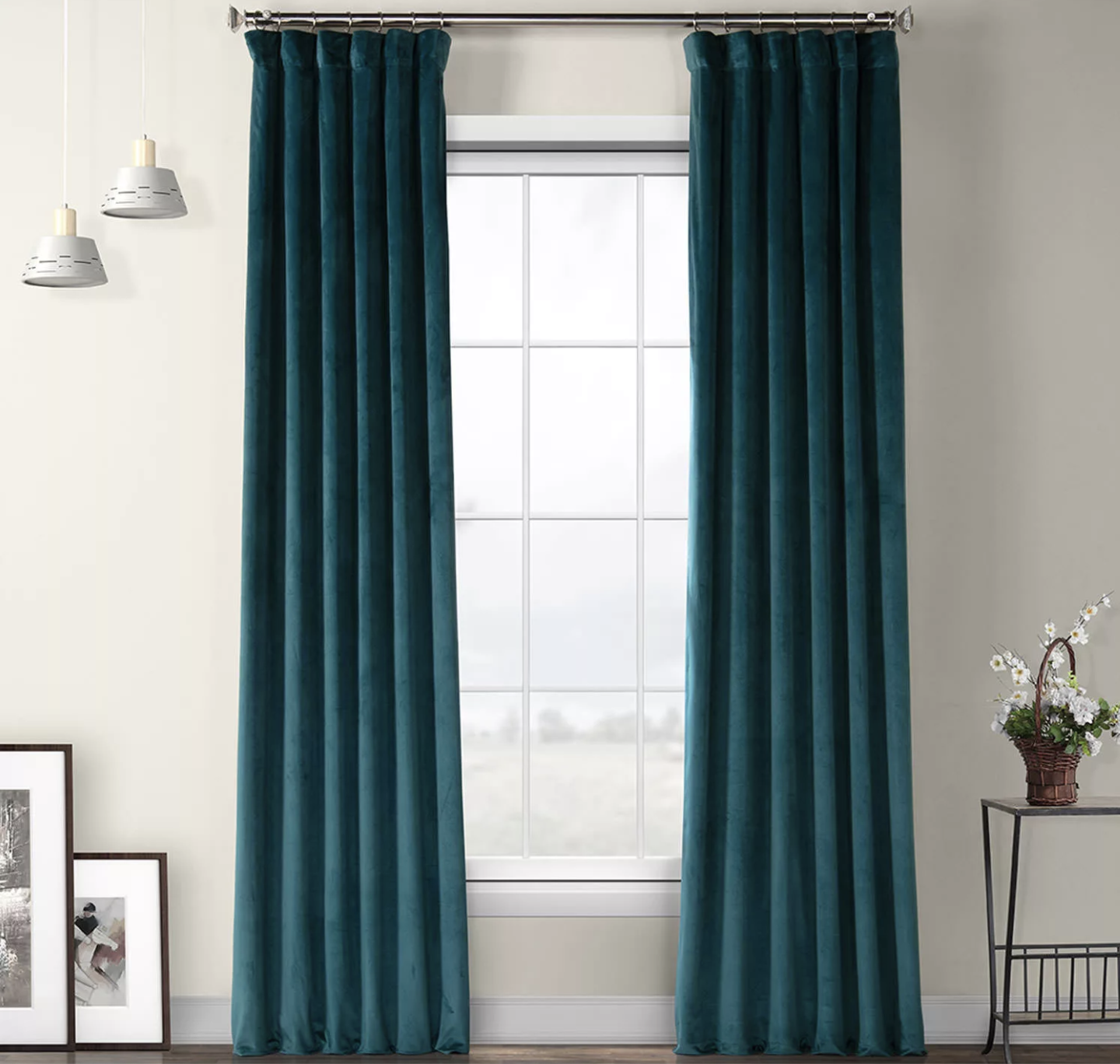 two deep sea teal heritage plush velvet curtains hanging from a window