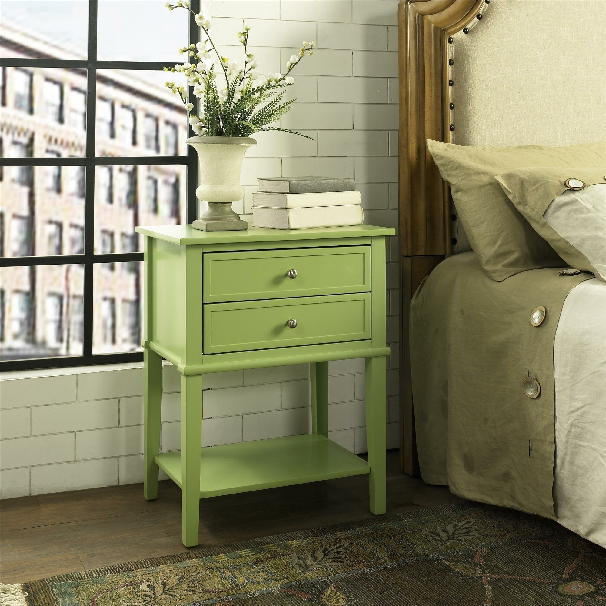 the green beachcrest home two drawer nightstand next to a bed