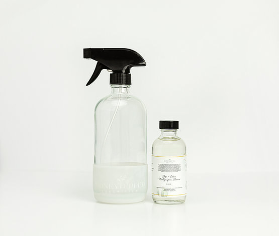 spray bottle with little bottle of cleaner
