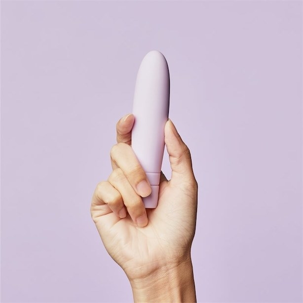 A person holding the rounded oval-shaped wand