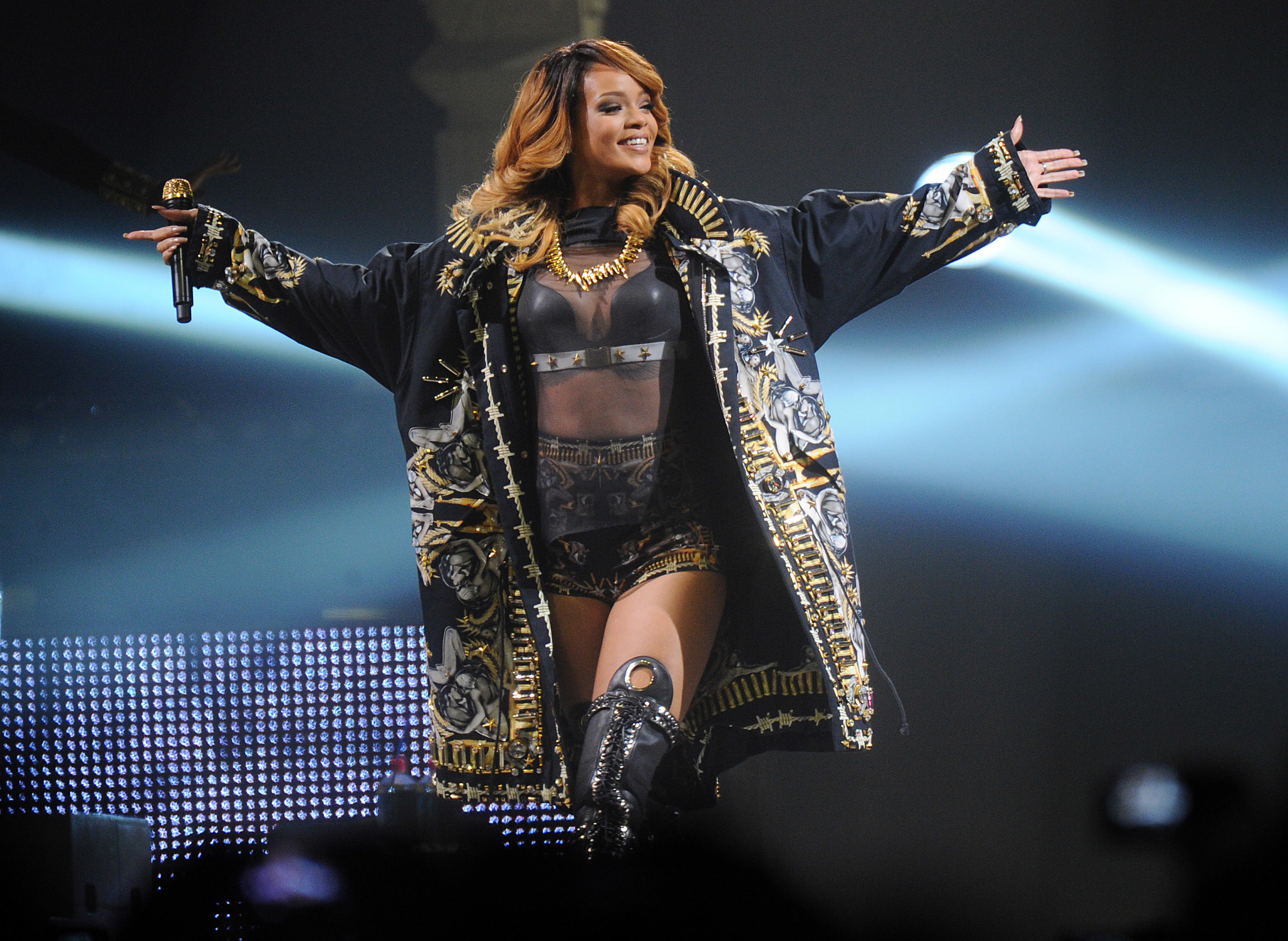 Rihanna performs during a concert in 2013