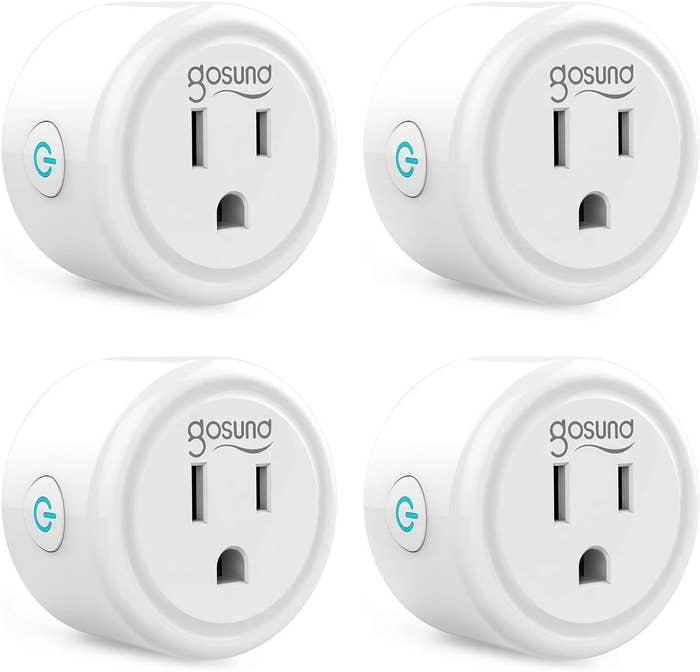 Four white smart plug mini outlets