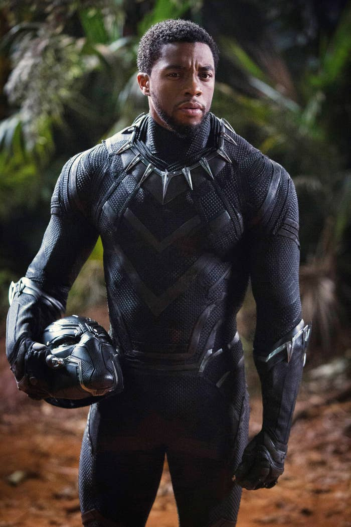 Chadwick Boseman holding his helmet in the film Black Panther