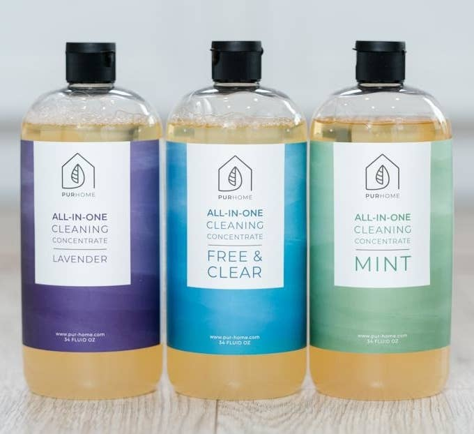 bottles of the concentrate in lavender, mint, and free and clear scents