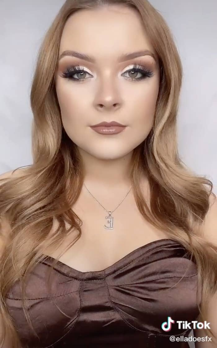 Ella with a soft glam makeup look and curled hair