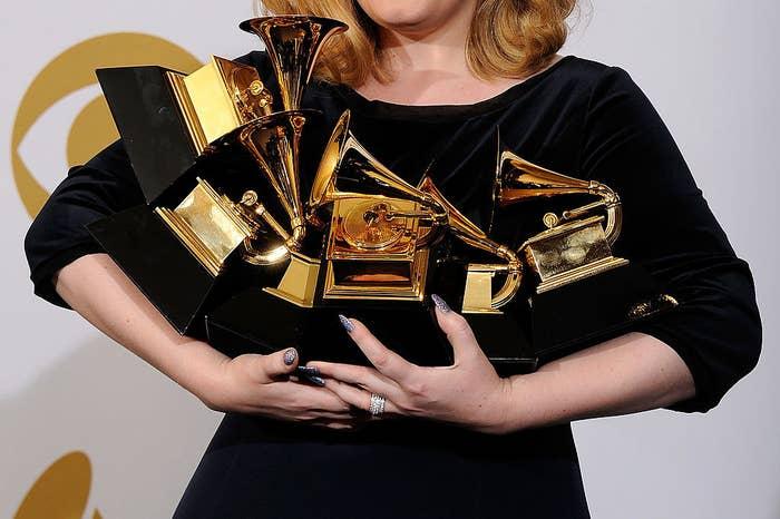 Adele holds her Grammys