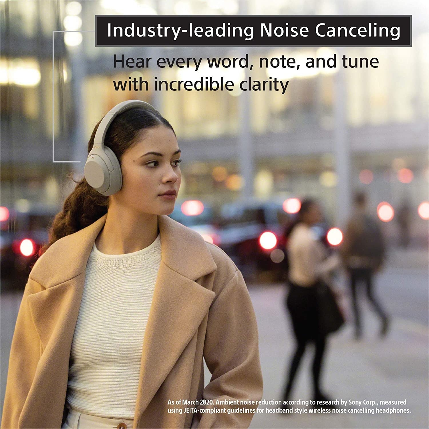 """Model wearing the white headphones with text on the image that says """"industry-leading noise canceling"""""""