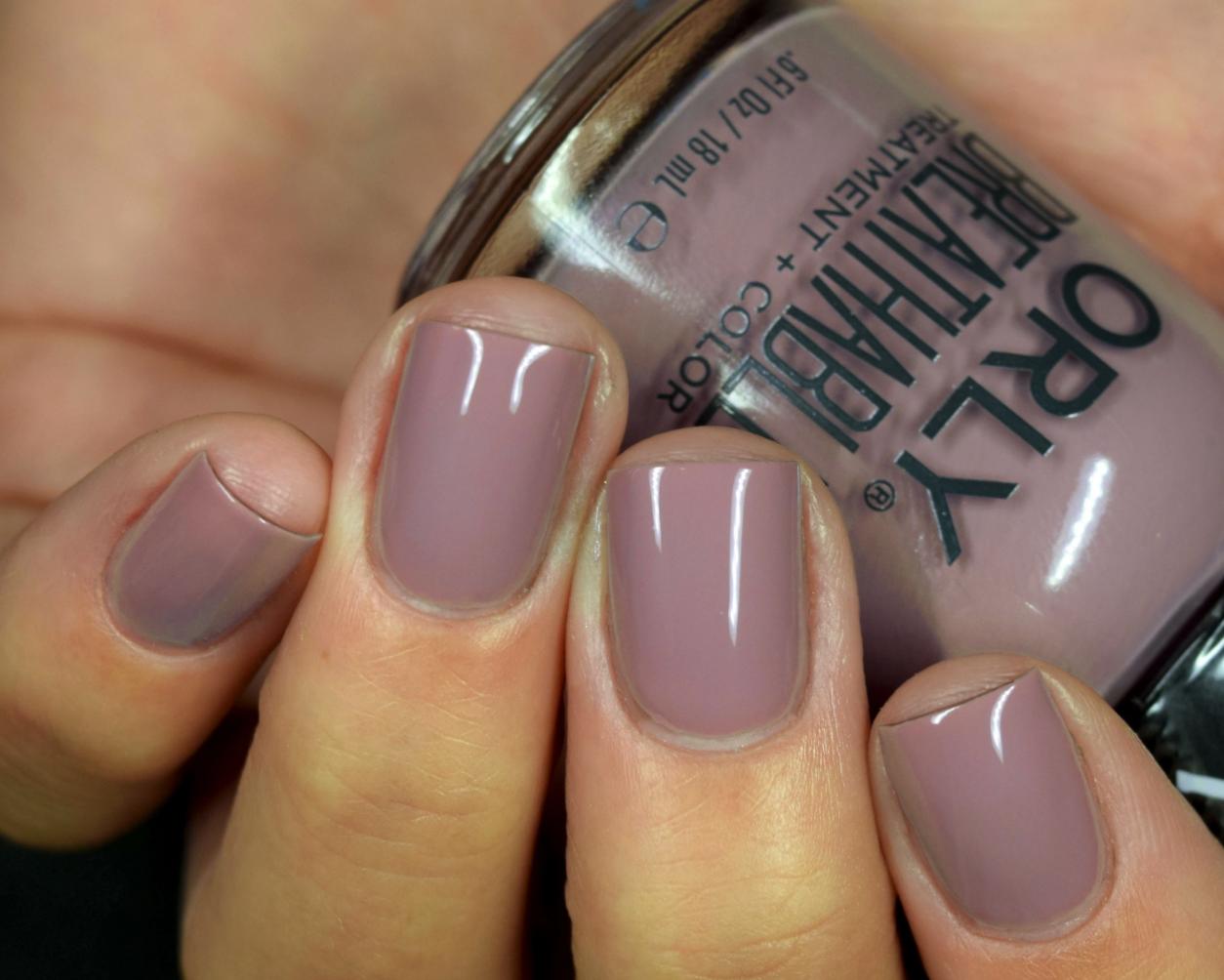hand wearing the mauve nail polish