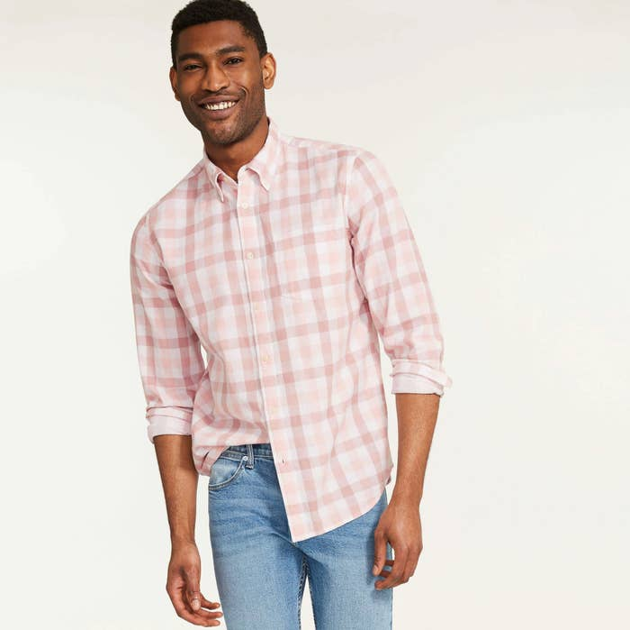 A person wearing a button up shirt with jeans