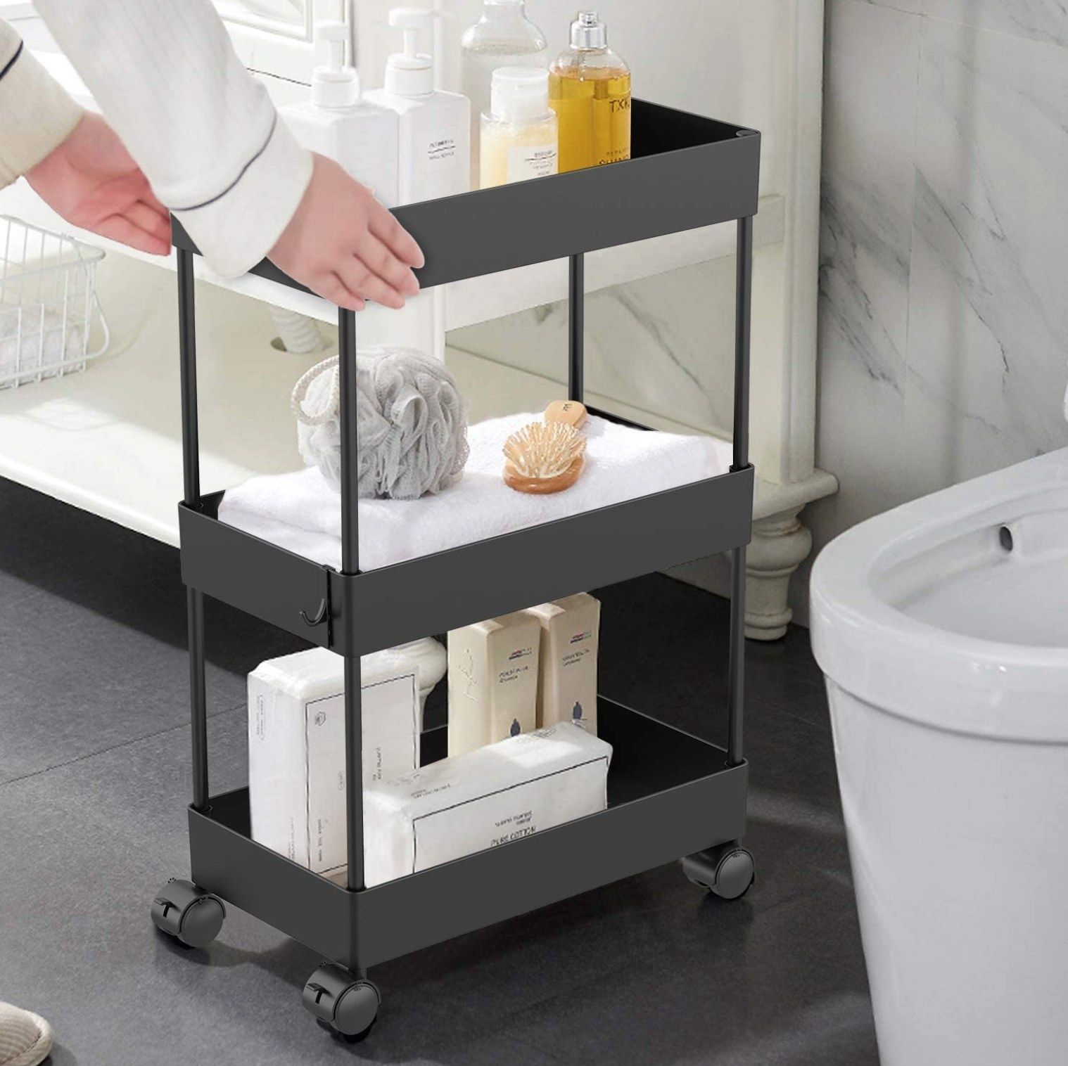 The cart with different bathroom products on it
