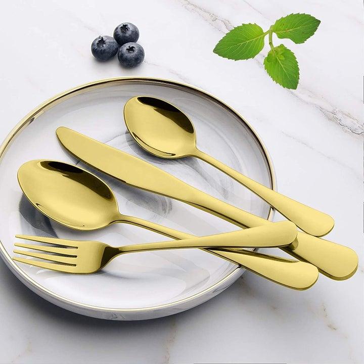 gold fork, knife, teaspoon, and dinner spoon