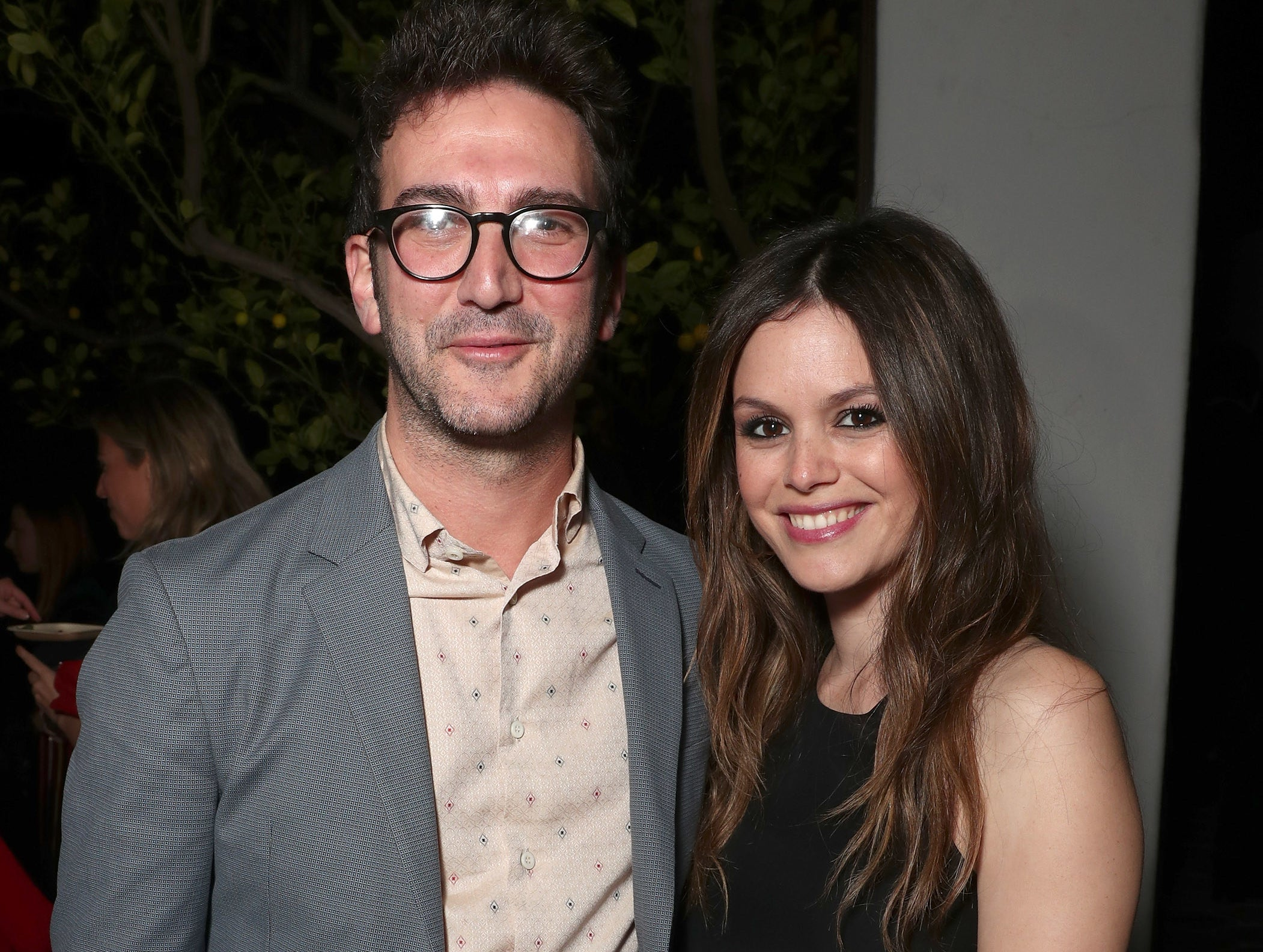 Rachel poses with Josh at an event