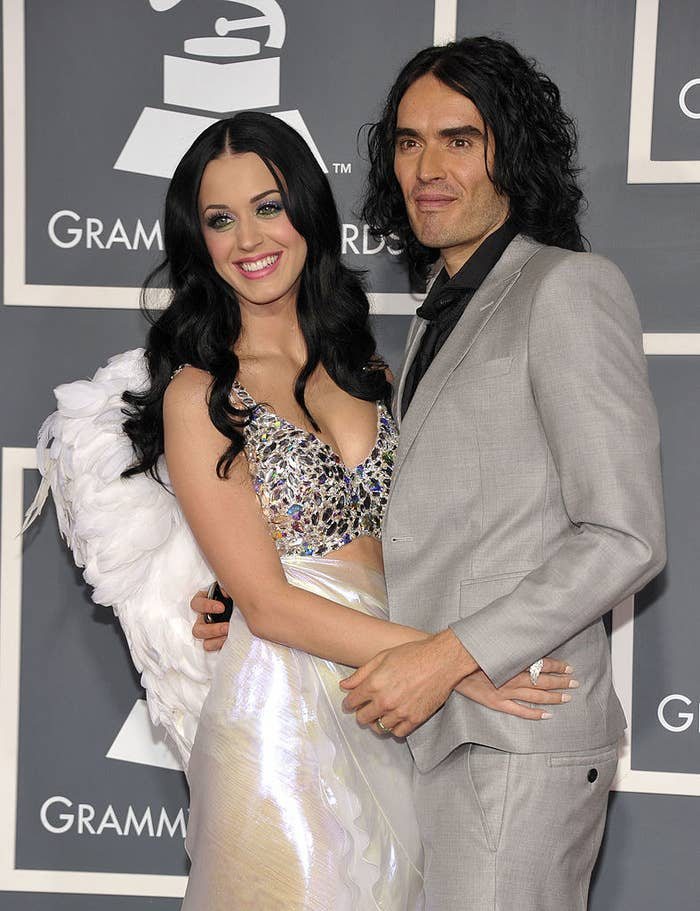 Katy and Russell embracing on the red carpet