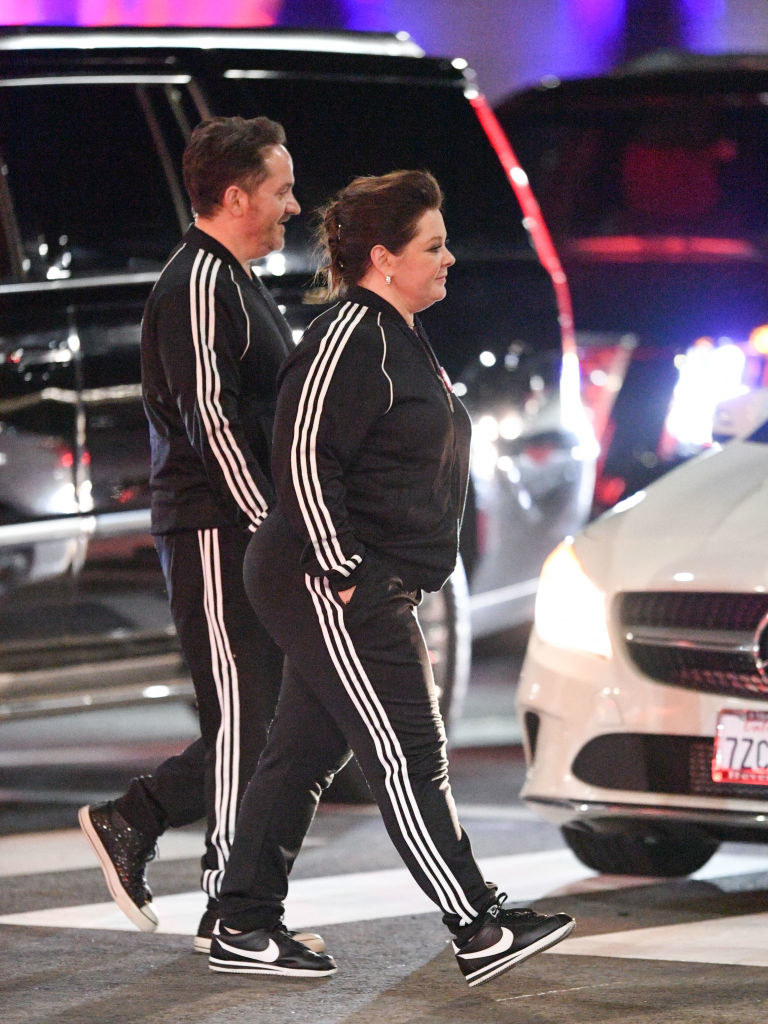 Melissa McCarthy and Ben Falcone are seen crossing a street in their matching tracksuits