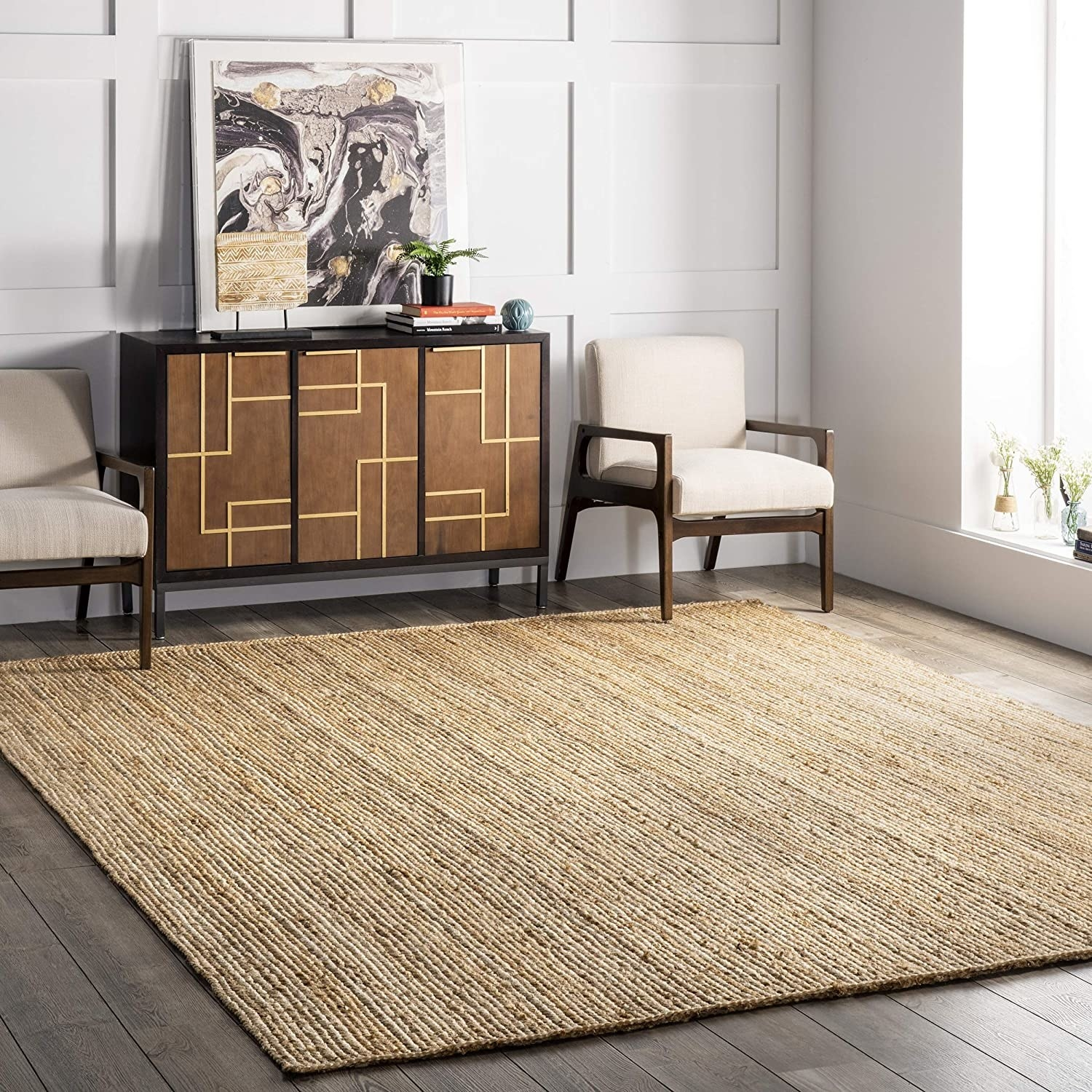 A tan woven area rug in a living room