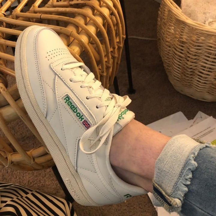 Reviewer wearing chalk colored reebok vintage sneaker