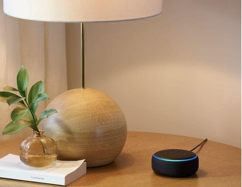 A black Echo Dot on a table