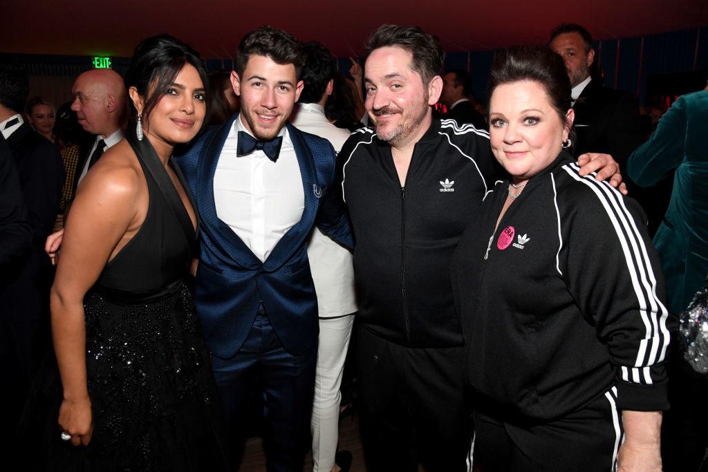 Priyanka Chopra, Nick Jonas, Ben Falcone, and Melissa McCarthy pose for a group photo at the 2019 Vanity Fair Oscar Party