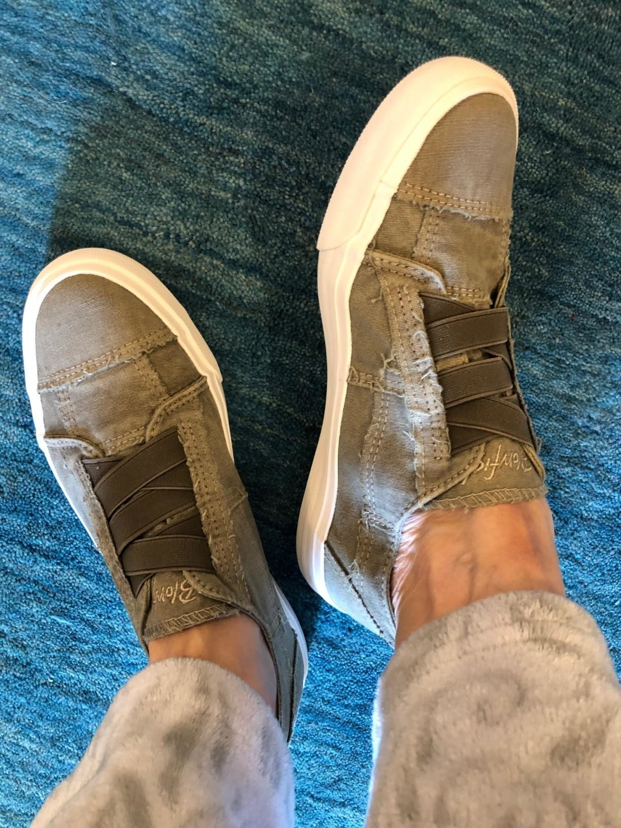reviewer wearing grey/green sneakers with elastic detail