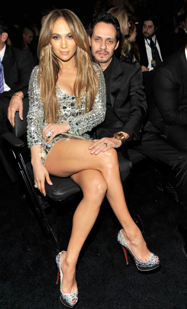 J Lo and Marc posing for a photo while in their seats