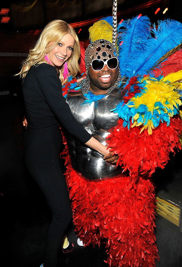 Cee Lo Green wearing a feathered costume with a breast plate