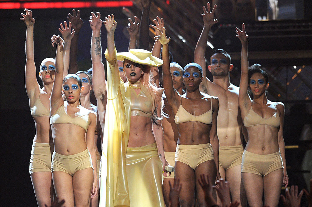 Lady Gaga hitting a move with her backup dancers