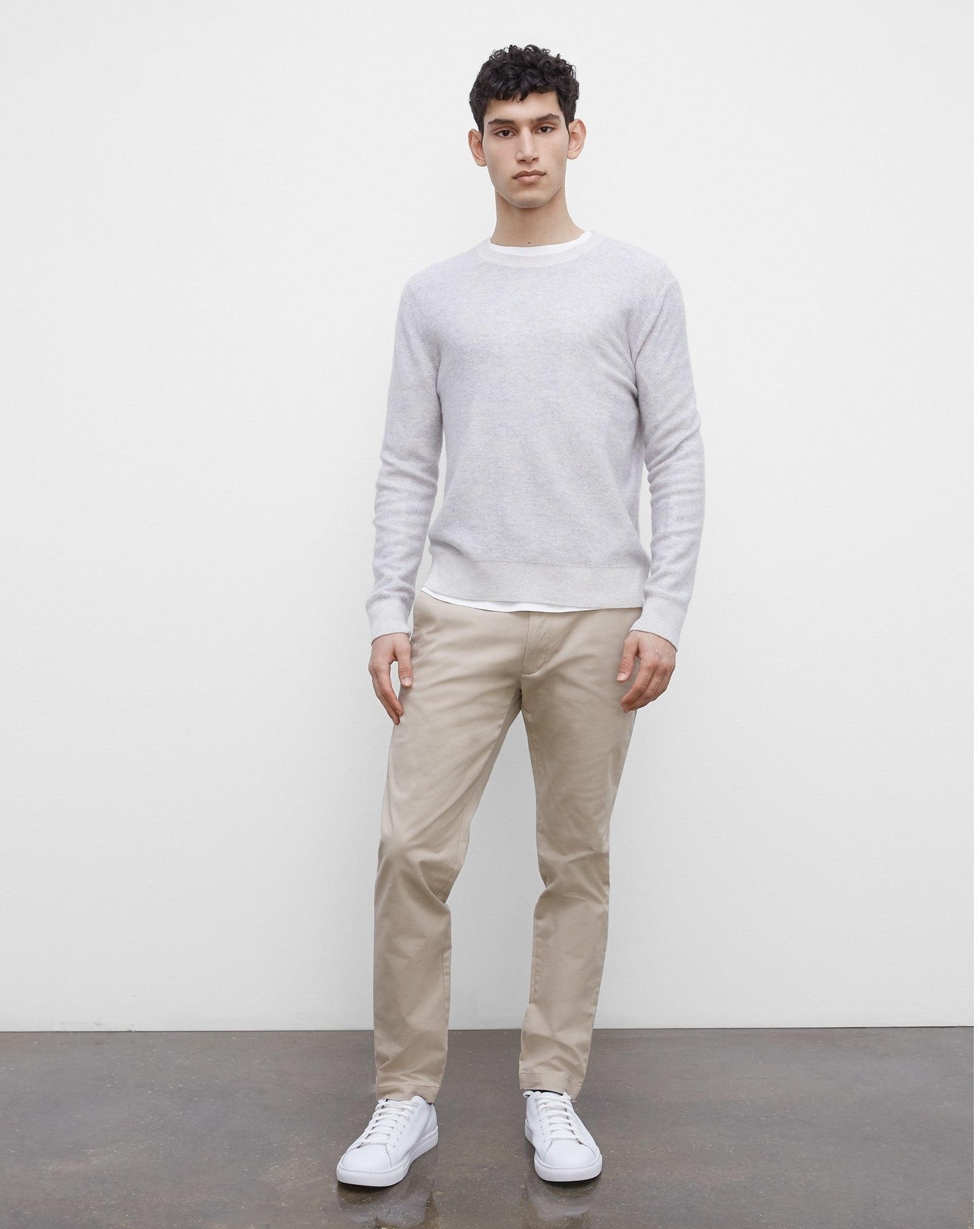 person wearing the chinos and a sweater