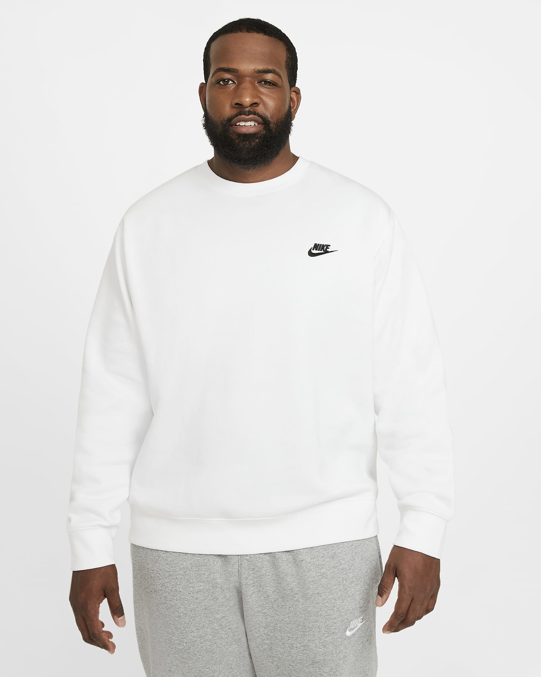 person wearing the crewneck