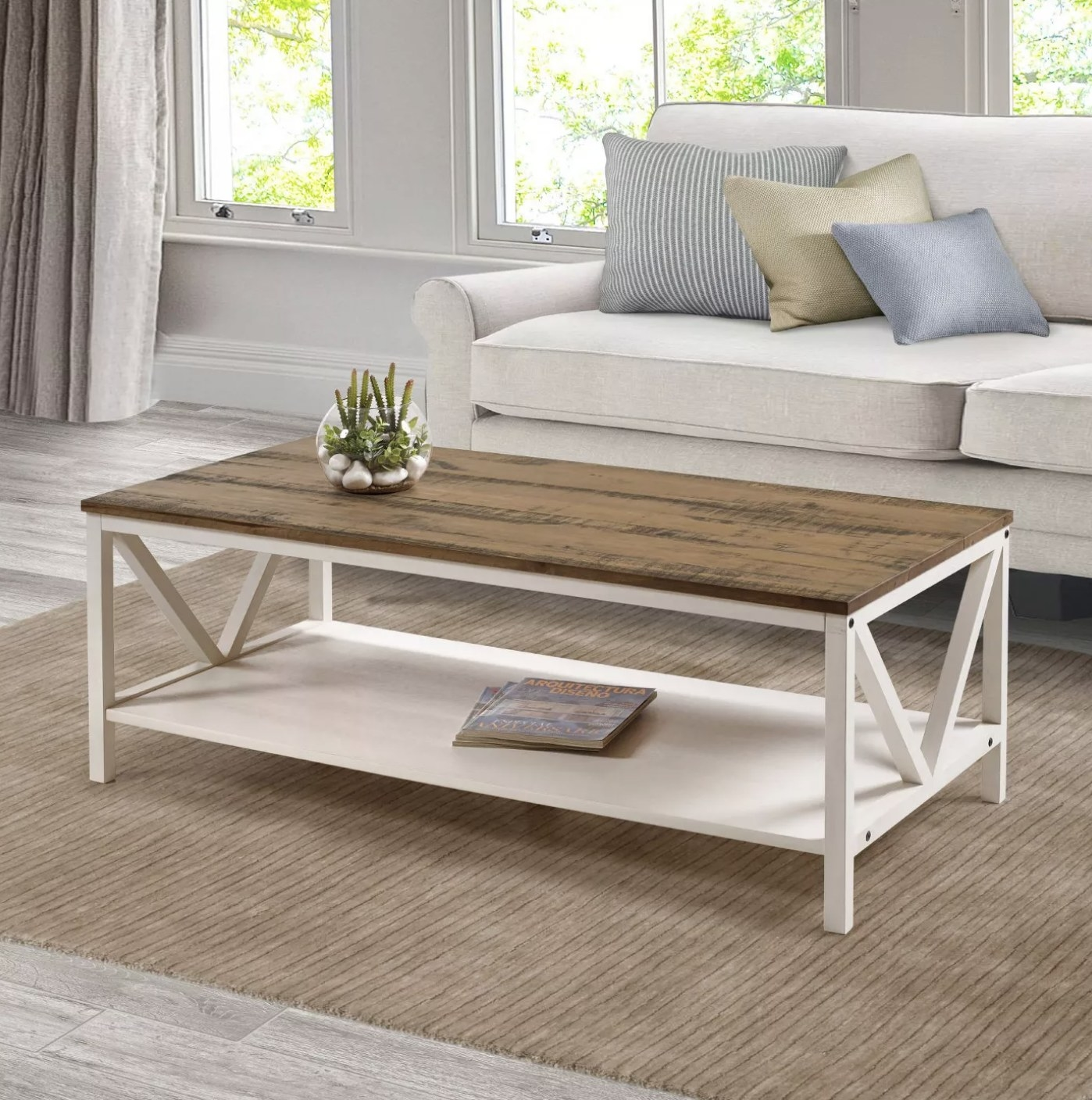 The wood coffee table with cream legs