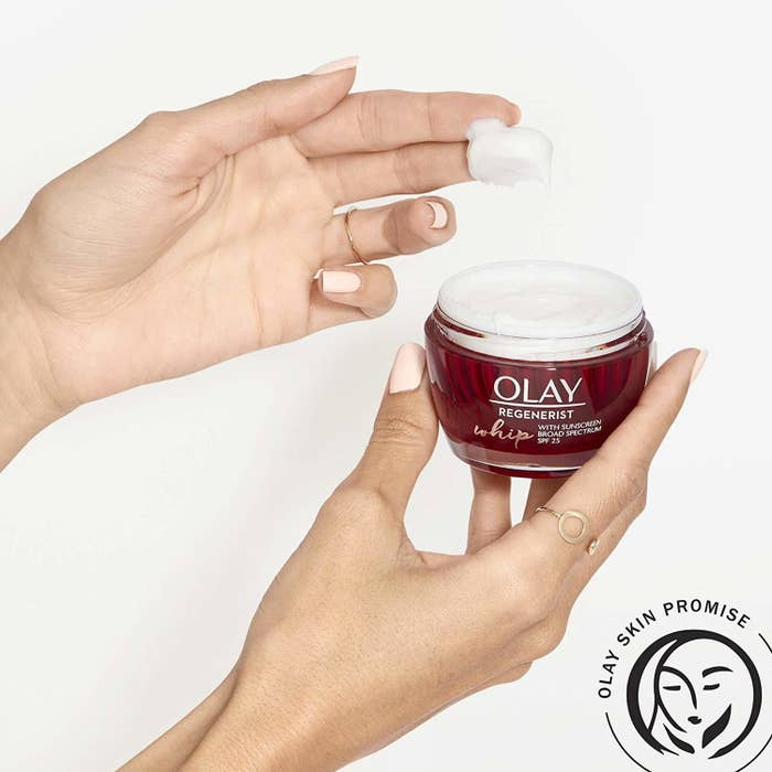 a hand showcasing the thin texture of the moisturizer