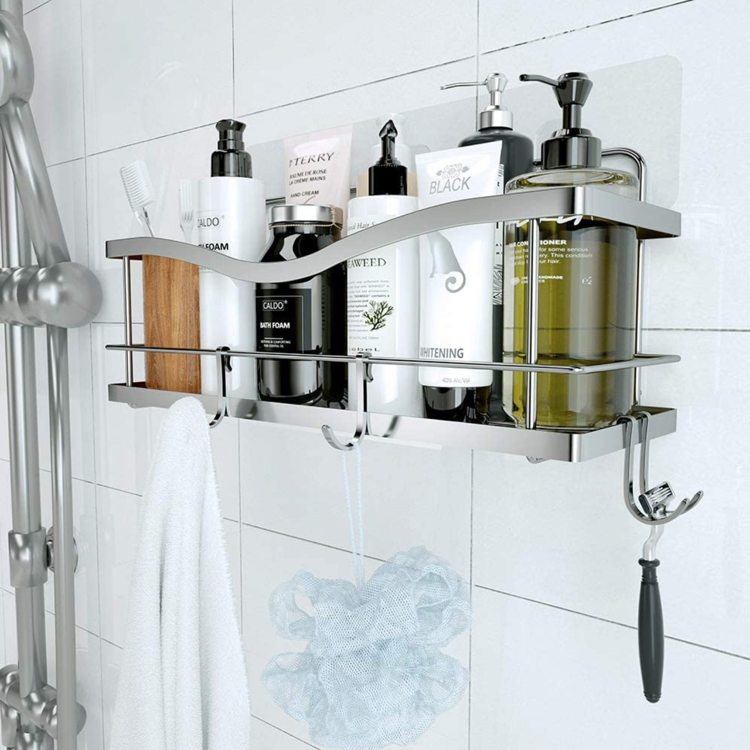 The shower caddy in silver with products on it