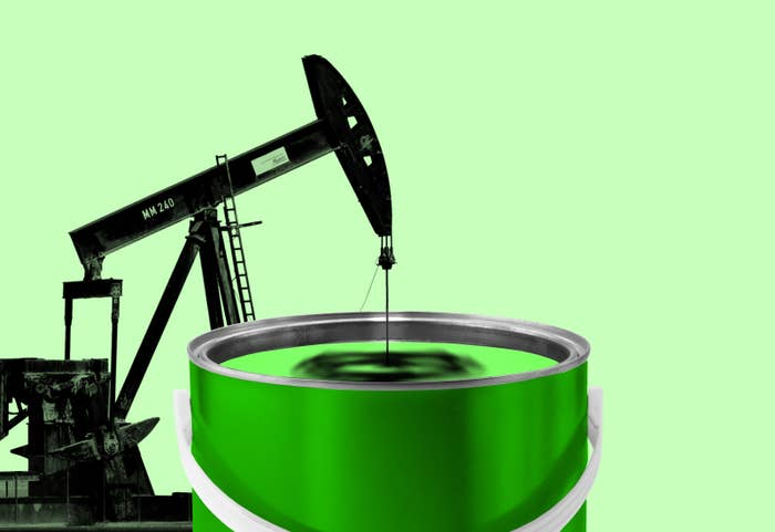 A graphic shows an oil rig dipping into a can of paint