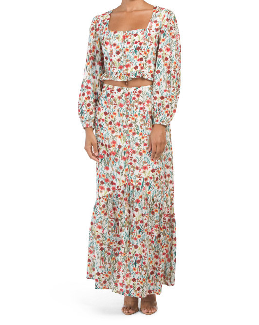 a long sleeve white top with colorful small florals all over it and matching maxi skirt
