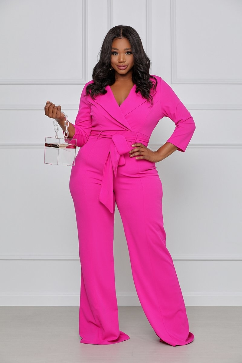 a model in a hot pink jumpsuit with a tie in the front