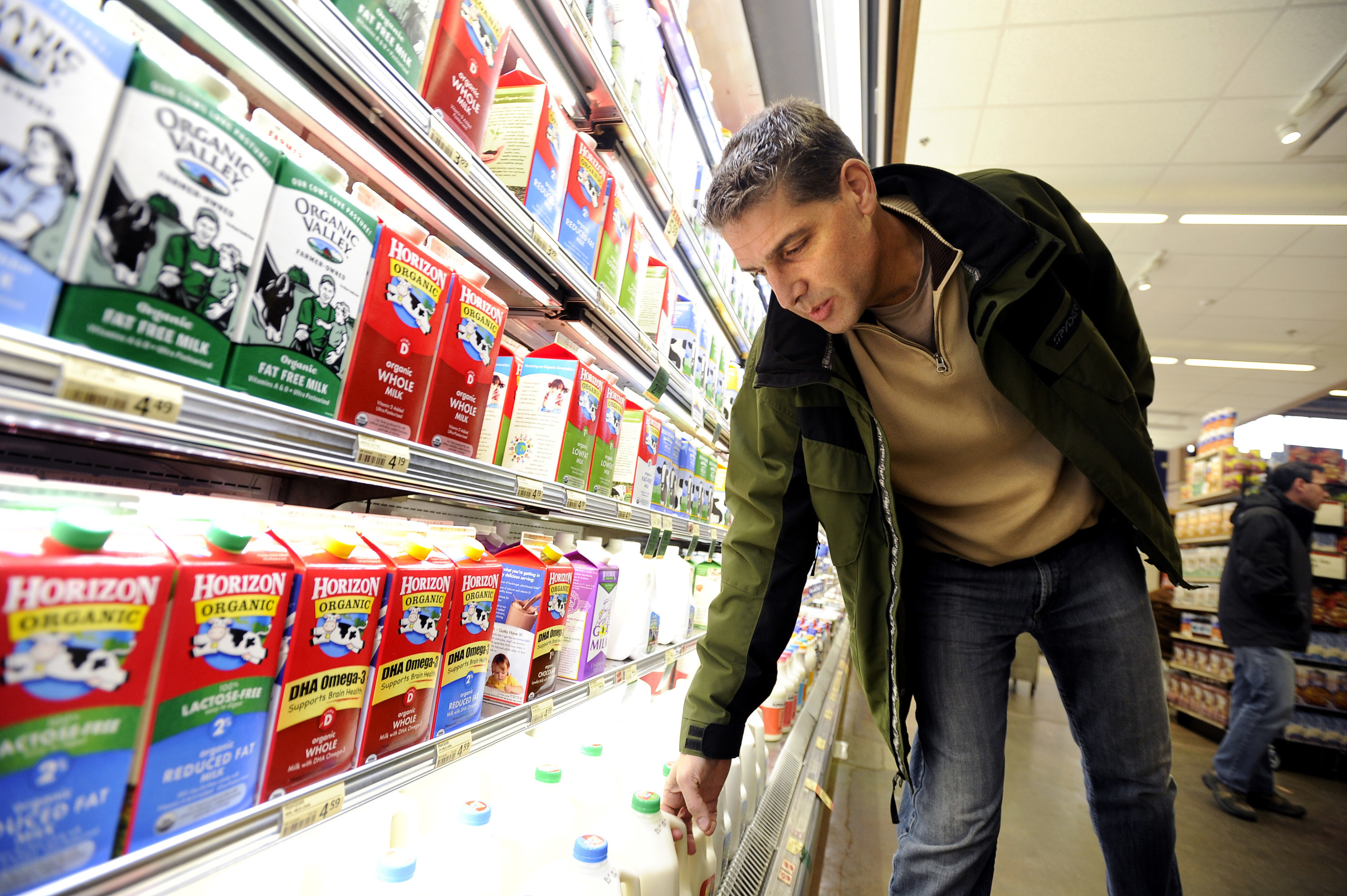 Man in the dairy aisle of the supermarket