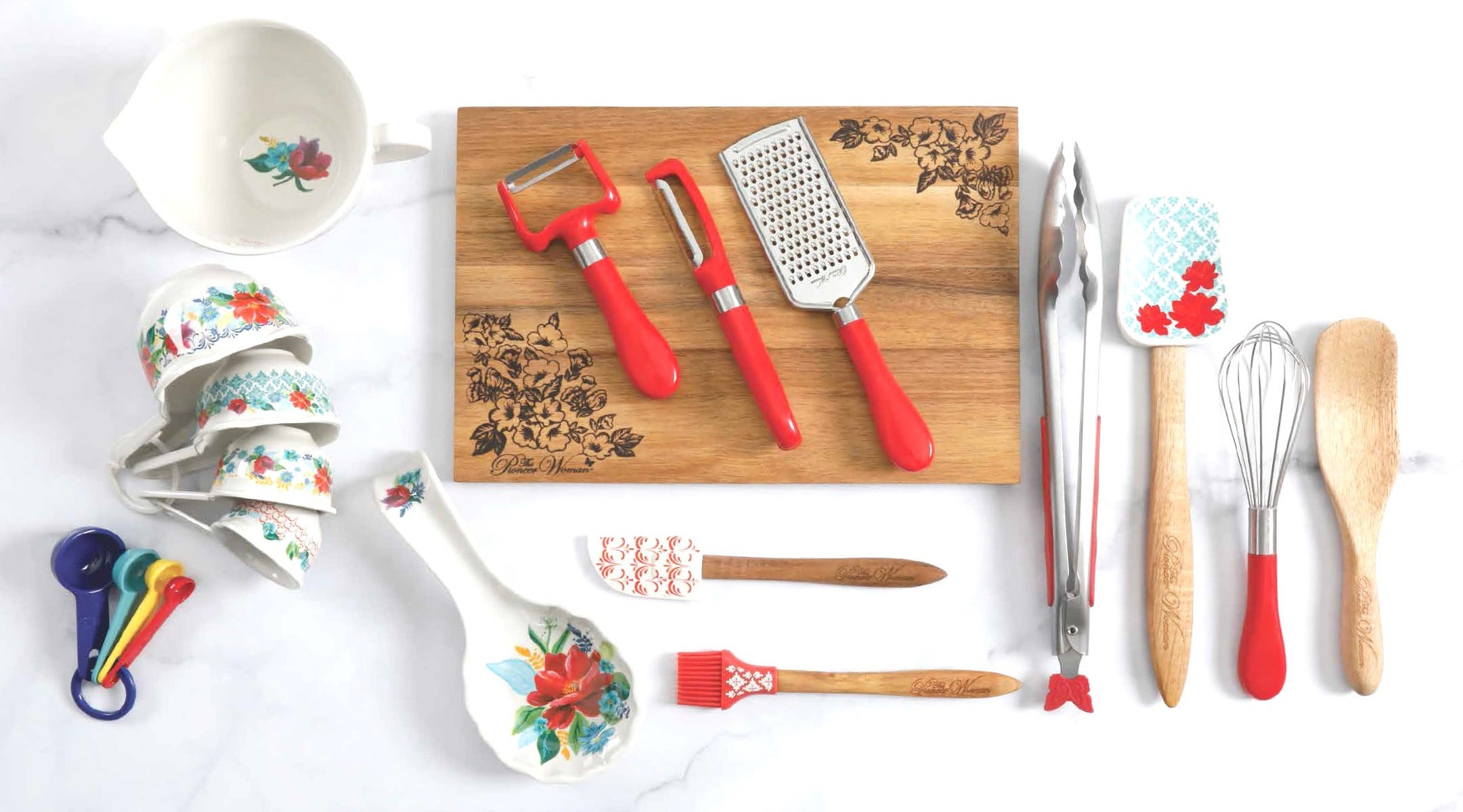 a 20-piece kitchen set displayed on a cutting board