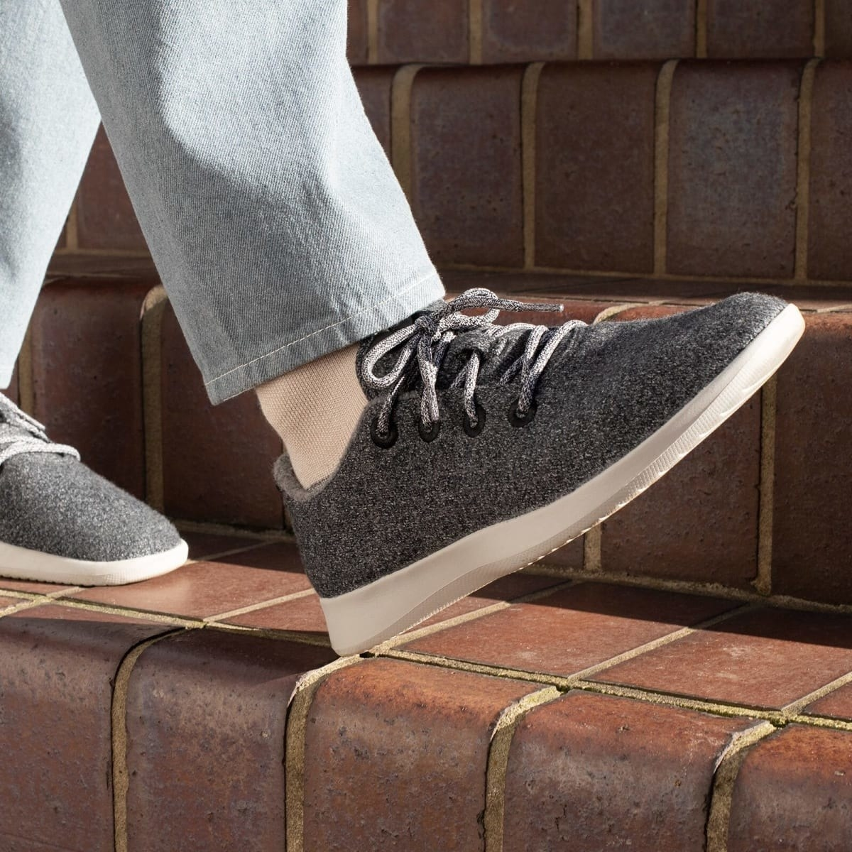 person walking on a step with the wool runners on