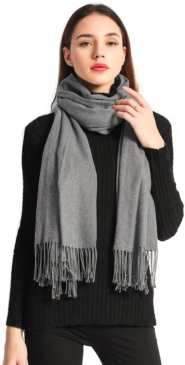 person wearing the scarf wrapped around their neck